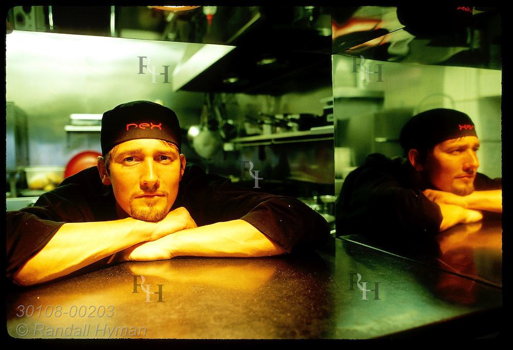 Chef Hallgrimur Ingi Thorlaksson of the futuristic-looking restaurant Rex Bar poses by kitchen serving window; Reykjavik, Iceland