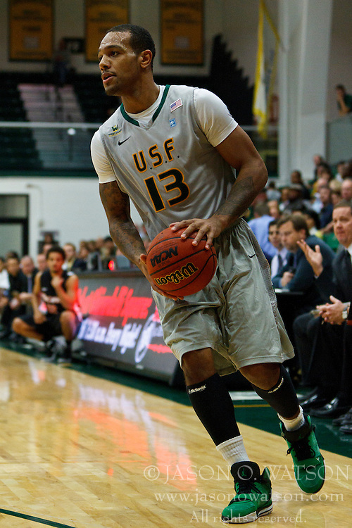 Dec 10, 2011; San Francisco CA, USA;  San Francisco Dons guard Rashad Green (13) holds the ball against the Pacific Tigers during the first half at War Memorial Gym.  San Francisco defeated Pacific 79-69. Mandatory Credit: Jason O. Watson-US PRESSWIRE
