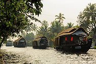 Three houseboats coming back to alleppey after an overnight in the famous backwaters