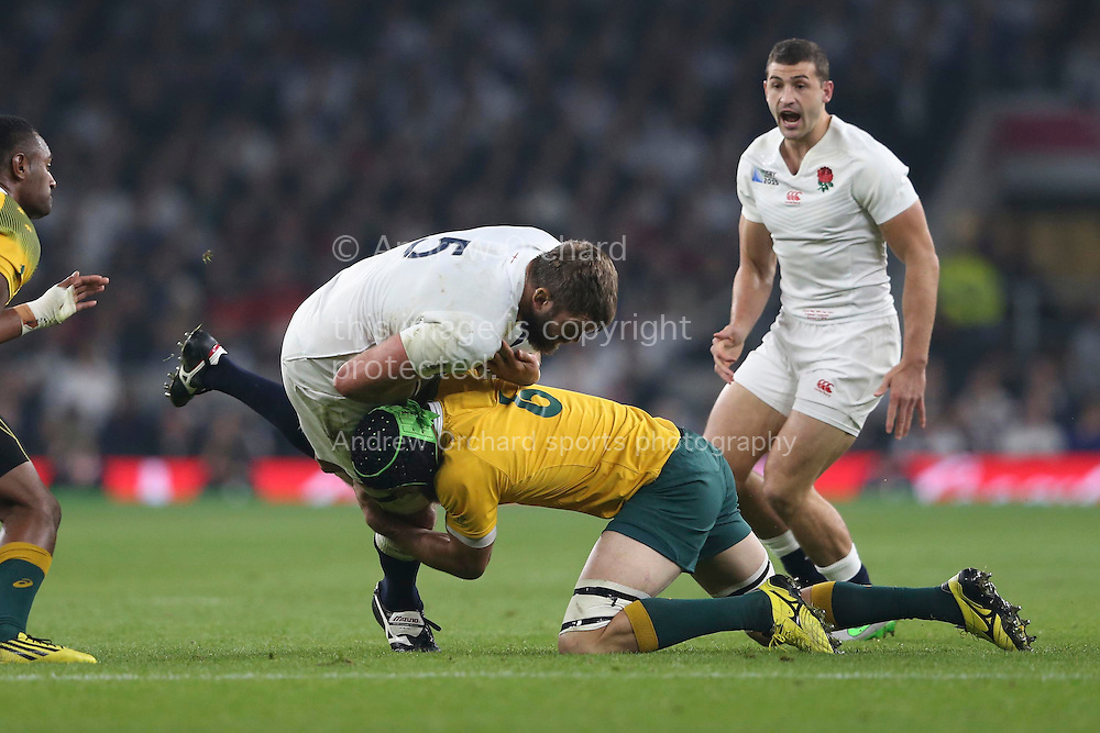Scott Fardy of Australia tacklies Geoff Parling of England. Rugby World Cup 2015 pool A match, England v Australia at Twickenham Stadium in London, England  on Saturday 3rd October 2015.<br /> pic by  John Patrick Fletcher, Andrew Orchard sports photography.