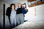 Lorp and Dimity in bedroom with beer, UK, 1980s.