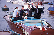 Silvio Berlusconi (R), President of Forza Italia political party, waves some fans from the tender of his ship, Portofino, June 6, 1998. In the morning Berlusconi  took part at a Convention in Santa Margherita of Young Entrepreneurs of Confindustria (employer's association). © Carlo Cerchioli