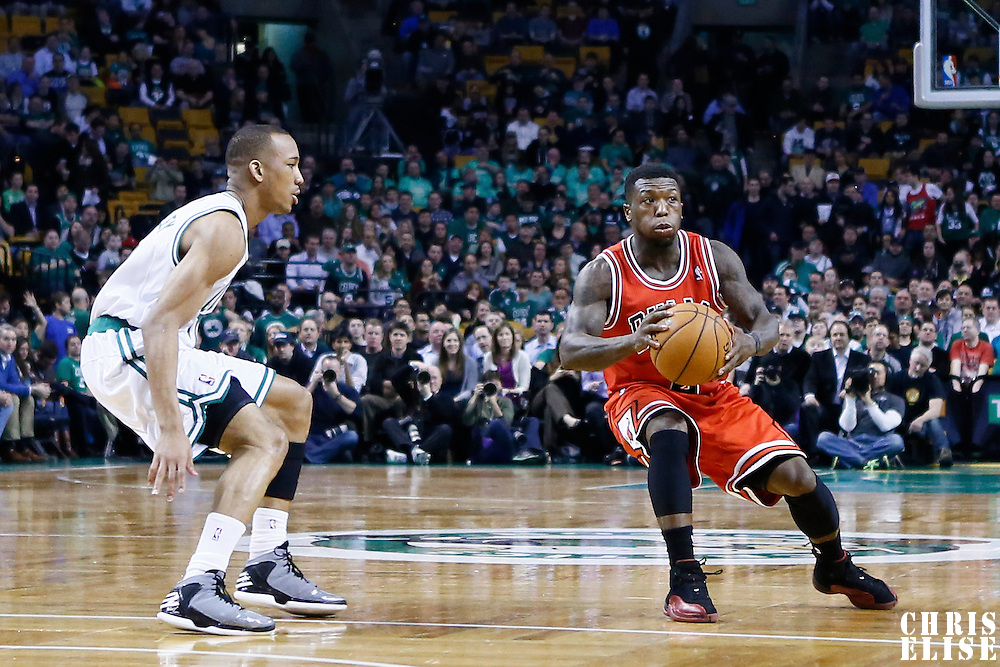 13 February 2013: Chicago Bulls point guard Nate Robinson (2) drives past Boston Celtics point guard Avery Bradley (0) during the Boston Celtics 71-69 victory over the Chicago Bulls at the TD Garden, Boston, Massachusetts, USA.