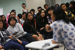 Students look on as Aishah gave a talk about her life to students at Ngee Ann Polytechnic in Singapore 24 June 2014. One of Aishah's main occupation now is giving inspirational talks where she shares her life and ordeal of overcoming her disability.