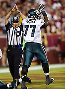 Philadelphia Eagles defensive end Damion Square (77) appears to join the officiating crew as he mimics an official calling a safety good for a 12-7 lead in the first quarter during the NFL week 1 football game against the Washington Redskins on Monday, Sept. 9, 2013 in Landover, Md. The Eagles won the game 33-27. ©Paul Anthony Spinelli