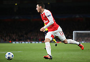 Arsenal midfielder Mesut Ozil dribbling during the Champions League match between Arsenal and Dinamo Zagreb at the Emirates Stadium, London, England on 24 November 2015. Photo by Matthew Redman.