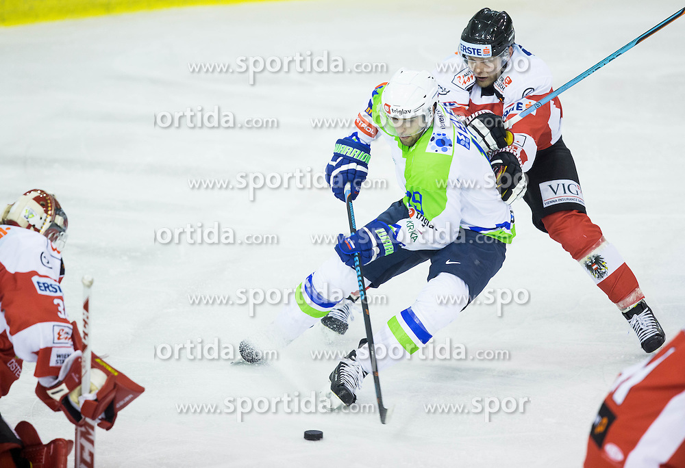 Ziga Pance of Slovenia vs Rene Swette of Austria and Daniel Mitterdorfer of Austria during ice-hockey friendly match between National teams of Slovenia and Austria, on April 19, 2015 in Hala Tivoli, Ljubljana, Slovenia. Photo by Vid Ponikvar / Sportida