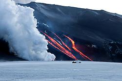 Volcanic eruption at Fimmvorduhals in Eyjafjallajokull. Burning lava floating like river stream, Iceland - Eldgos á Fimmvörðuhálsi, brennandi eldhraun rennur eins og foss