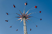 Children flying around a pole in the amusement park of Coney Island, Brooklyn, NY.