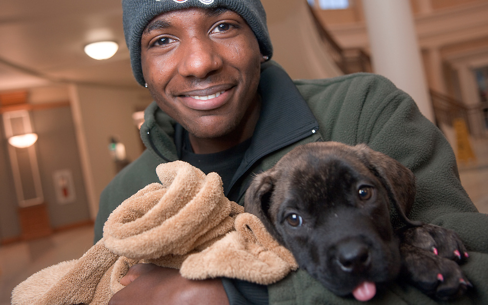 18526Students  in Baker Center...Antonio Oliver and Blair the dog