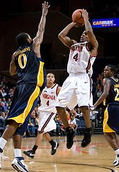 Virginia guard Sean Singletary (44) shoots over Drexel guard Tramayne Hawthorne (0).  The #23 Virginia Cavaliers men's basketball team defeated Drexel Dragons 72-58 at the John Paul Jones Arena in Charlottesville, VA on November 20, 2007.