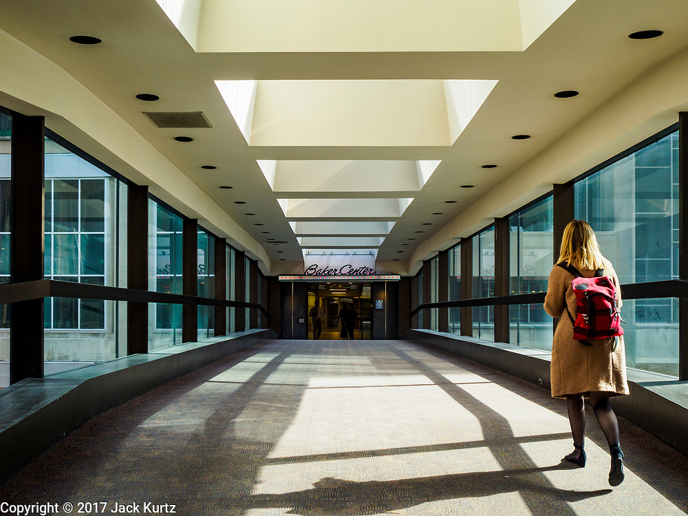 03 MAY 2017 - MINNEAPOLIS, MN: The skyway going into Baker Center, a newer building in downtown Minneapolis. The skyways are enclosed pedestrian overpasses that connect downtown buildings. The Minneapolis Skyway was started in the early 1960s as a response to covered shopping malls in the suburbs that were drawing shoppers out of the downtown area. The system grew sporadically until 1974, when the construction of the IDS Center and its center atrium, called the Crystal Court, served as a hub for the downtown skyway system. There are 8 miles of skyways, connecting most of the downtown buildings from Target Field (home of the Minnesota Twins) to US Bank Stadium (home of the Minnesota Vikings). In the last five years many upscale downtown apartment buildings and condominium developments have been added to the system, allowing downtown residents to live and work downtown without going outside.    PHOTO BY JACK KURTZ