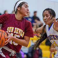 Rough Rock Sun Devil Lakota Curley (15) holds off Valley Sanders Pirate Codi Spencer (24) Wednesday at Valley Sanders High School.