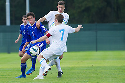 Max Llovera of Andorra vs Rok Jazbec and Dino Hotic of Slovenia during football game between Slovenia and Andorra of<br /> UEFA Under19 Championship Qualifications, on October 15, 2013 in Bakovci, Slovenia. (Photo by Erik Kavas / Sportida)