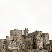 Overcast skies at Harlech Castle in Harlech, Gwynedd, on the northwest coast of Wales next to the Irish Sea. The castle was built by Edward I in the closing decades of the 13th century as one of several castles designed to consolidate his conquest of Wales.