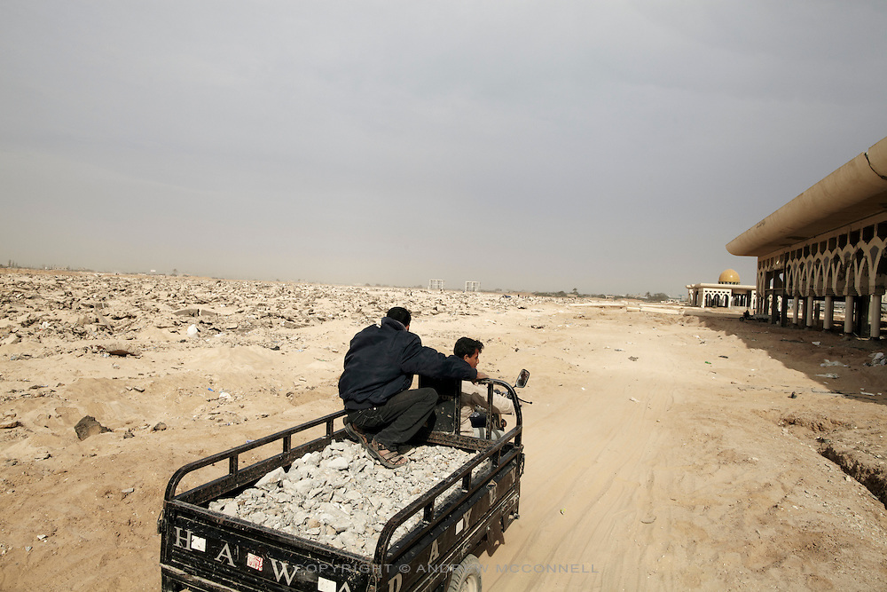 Men remove rubble from Yasser Arafat International Airport in southern Gaza. The rubble fetches 50 Shekels (approx EUR10) per tonne and is used for the production of concrete.