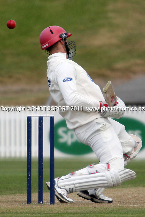 Andrew Ellis ducks under a boucer during day three of the plunket shield cricket match between the Northern Knights and Canterbury Wizards . Domestic 4 day cricket, Seddon Park, Hamilton. 1 December 2011. Photo: Dion Mellow / photosport.co.nz