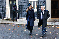 © Licensed to London News Pictures. 10/11/2019. London, UK. Prime Minister, Boris Johnson and his girlfriend, Carrie Symonds leave Downing Street to attend the Remembrance Sunday Ceremony at the Cenotaph in Whitehall. Remembrance Sunday events are held across the country today as the UK remembers and honours those who have sacrificed themselves in two world wars and other conflicts. Photo credit: Vickie Flores/LNP