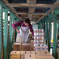 Caleb Thompson, a volunteer from the Church of Jesus Christ of Latter-day Saints, helps organize inventory in the warehouse of the Community Pantry in Gallup Wednesday.