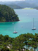Eastward view from atop Motuarohia Island across the Bay of Islands. Sailboats moored.