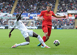 Modou Barrow of Swansea City tackles James Milner of Liverpool - Mandatory by-line: Alex James/JMP - 01/10/2016 - FOOTBALL - Liberty Stadium - Swansea, England - Swansea City v Liverpool - Premier League