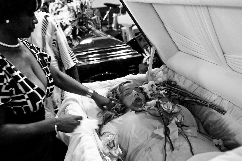 Mourners view the casket of 33 year-old Bernice King at the Pilgrim Baptist Church in Gary, Indiana. King was overcome by smoke and perished while trying to save her daughter Angel, 14, when her home was set ablaze after an argument over an Xbox and a trade for marijuana. The suspected teen arsonist was shot 9 times the following morning and is now in custody facing murder and arson charges. (© William B. Plowman/Redux)