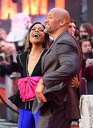 Naomie Harris and Dwayne Johnson attending the European premiere of Rampage, held at the Cineworld in Leicester Square, London. Picture date: Wednesday April 11, 2018. See PA story SHOWBIZ Rampage. Photo credit should read: Ian West/PA Wire