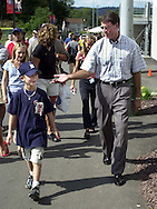 """Baseball Hall of Fame pitcher Jim Palmer (R), walks with Evan McDaniel (L), winner of the """"OxiClean True Grit"""" contest, outside Lamade Stadium, in which he and his teammates from Leesburg, Virginia, won a trip to the Little League World Series, Sunday, August 25, 2002, in South Williamsport, Pennsylvania. (Photo by William Thomas Cain/photodx.com)"""