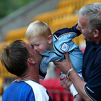 St Johnstone v Hamilton Accies..31.07.04  Bell's Cup<br />Ian Maxwell gets a kiss from his son Christopher at the end of the game<br /><br />Picture by Graeme Hart.<br />Copyright Perthshire Picture Agency<br />Tel: 01738 623350  Mobile: 07990 594431