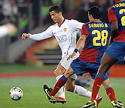 Cristiano Ronaldo and Sergio Busquets battle for the ball during the final of the UEFA football Champions League on May 27, 2009 at the Olympic Stadium in Rome.