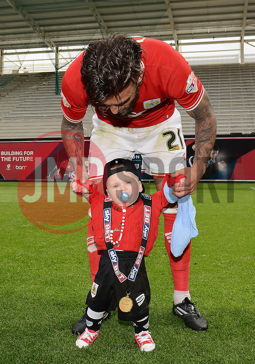 Bristol City's Marlon Pack celebrates with his child - Photo mandatory by-line: Dougie Allward/JMP - Mobile: 07966 386802 - 03/05/2015 - SPORT - Football - Bristol - Ashton Gate - Bristol City v Walsall - Sky Bet League One