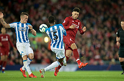 LIVERPOOL, ENGLAND - Friday, April 26, 2019: Liverpool's Alex Oxlade-Chamberlain (R) and Huddersfield Town's Terence Kongolo (L) during the FA Premier League match between Liverpool FC and Huddersfield Town AFC at Anfield. (Pic by David Rawcliffe/Propaganda)