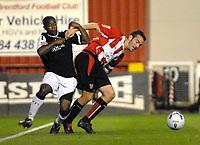 Photo: Ed Godden.<br /> Brentford v Swansea City. Coca Cola League 1. 12/09/2006. Leon Knight (R) holds back Brentford's Kevin O'Connor.