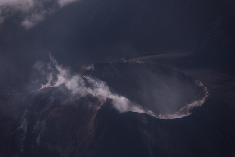 A smoking volcano seen from the air, Vanuatu.