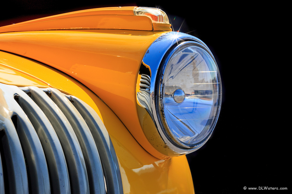 Yellow and car headlight contrasts with deep shadows in the background.