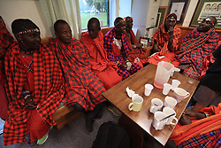 Maasai Warriors' cricket team shelter from the rain against Nottingham Knights Visually Impaired Cricket Club during their UK tour to raise awareness of gender inequality, the End FGM Campaign, hate crime, modern slavery, conservation and promoting their culture and country, Kenya
