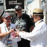 Team owner Jack Roush signs autographs for fans in the garage area at Daytona International Speedway on February 18, 2011 in Daytona Beach, Florida. (AP Photo/Alex Menendez)