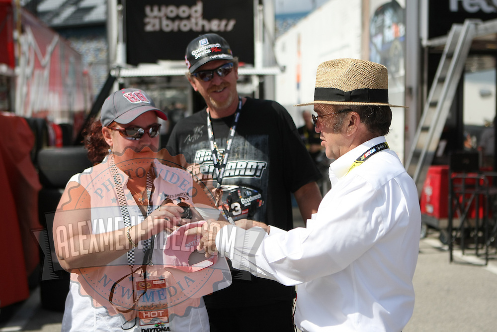 Team owner Jack Roush signs autographs for fans in the garage area at Daytona International Speedway on February 18, 2011 in Daytona Beach, Florida. (AP Photo/Alex Menendez)