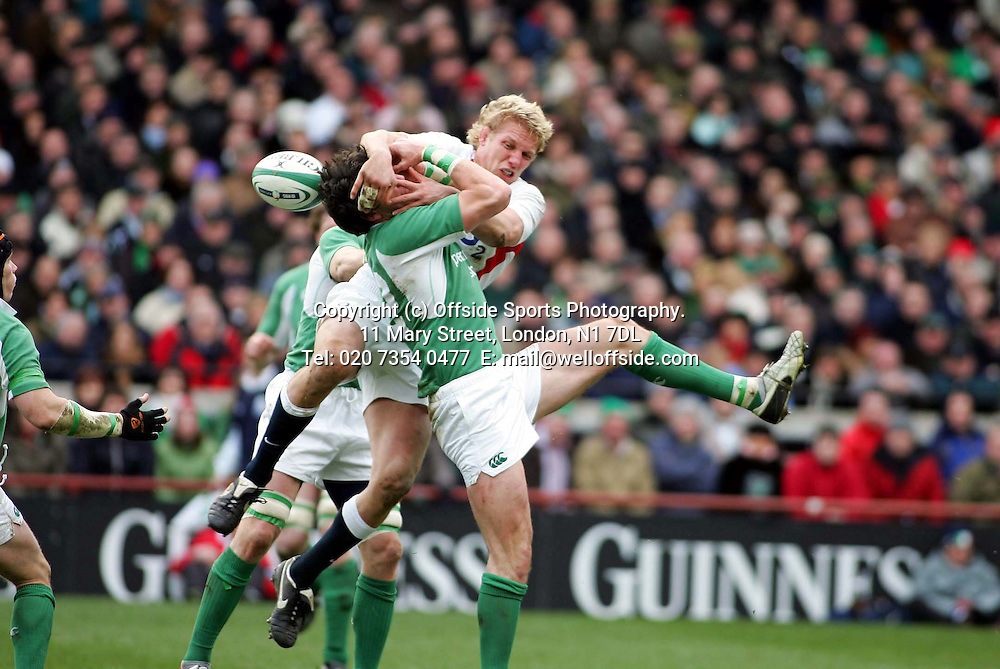 27/02/2005 Ireland-England  6 Nations Rugby<br /> Lewis Moody clatters Shane Horgan as they contest the ball at a restart.<br /> Photo: Mark Leech / Offside
