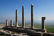 Low angle view of a row of columns from the Temple of Saturn, built around 200 A.D. Dougga, Tunisia, pictured on January 31, 2008, in the morning. Dougga has been occupied since the 2nd Millennium BC, well before the Phoenicians arrived in Tunisia. It was ruled by Carthage from the 4th century BC, then by Numidians, who called it Thugga and finally taken over by the Romans in the 2nd century. Situated in the north of Tunisia, the site became a UNESCO World Heritage Site in 1997. This temple was previously the site of the Punic Temple of Baal. The entrance had four Corinthian columns which remains are still visible. Picture by Manuel Cohen.