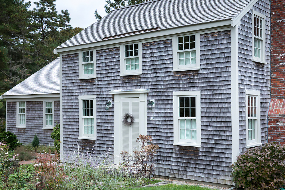 Traditional wood shingle timber architecture of house by Cockle Cover at Chatham, Cape Cod, New England, USA