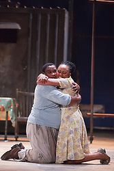 "© Licensed to London News Pictures. 10/07/2012.  London, England. Nonhlanhla Yende as Bess and Xolela Sixaba as Porgy. London Premiere of Cape Town Opera's fully-staged production of the Gershwin Opera ""Porgy and Bess"" at the London Coliseum. A limited season of 14 performances from 11 to 21 July 2012. Directed by Christine Cross, Music/Lyrics by George Gershwin, DuBose and Dorothy Heyward and Ira Gershwin, accompanied by the Orchestra of Welsh National Opera. Photo credit: Bettina Strenske/LNP"