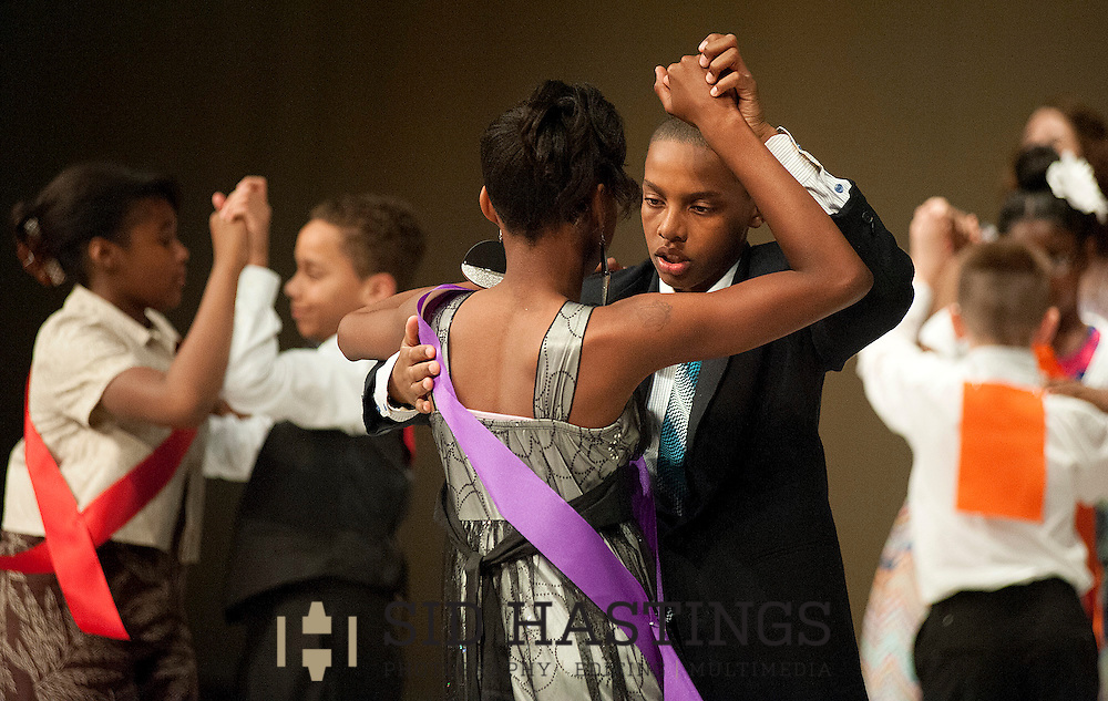 14 MAY 2013 -- ST. LOUIS -- Washington Elementary School fifth grade students Nyia Nash (left) and Jalen Johnson participate in the first round of competition during the St. Louis Dancing Classrooms ballroom dance championship at the Scottish Rite Cathedral auditorium in St. Louis Tuesday, May 14, 2013. Photo © copyright 2013 Sid Hastings.