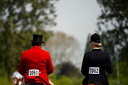 © London News Pictures. 12/05/2016. Windsor, UK. A male and female rider in different colours make their way back from competition on the first day of the 2016 Royal Windsor Horse Show, held in the grounds of Windsor Castle in Berkshire, England. The opening day of the event was cancelled due to heavy rain and waterlogged grounds. This years event is part of HRH Queen Elizabeth II's 90th birthday celebrations.  Photo credit: Ben Cawthra/LNP
