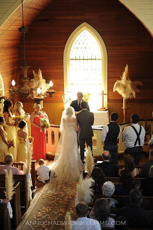 A bride and groom marry in The Emmanuel Church in Coloma, California.