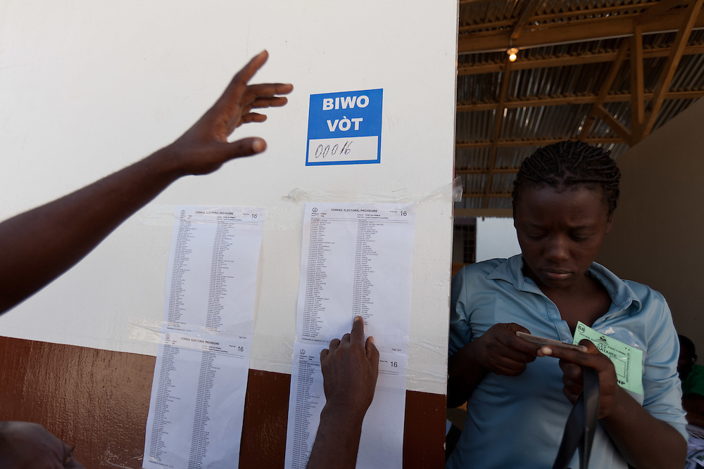 Many registered voters are not able to find their names on lists that allow them to vote at this voting station.