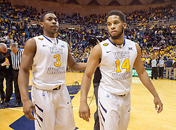 West Virginia Mountaineers guard Juwan Staten (3) and West Virginia Mountaineers guard Gary Browne (14) walk off the floor after beating the Texas Longhorns at the WVU Coliseum.