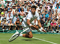 Tennis - 2019 Wimbledon Championships - Week Two, Friday (Day Eleven)<br /> <br /> Men's Singles, Semi-Final: Novak Djokovic (SRB) vs. Roberto Bautista Agut (ESP)<br /> <br /> Novak Djokovic loses his racket as he dives at the net, on Centre Court.<br /> <br /> COLORSPORT/ANDREW COWIE