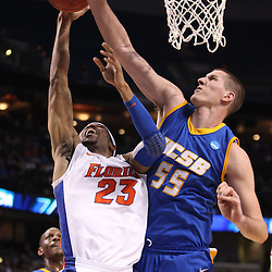 Mar 17, 2011; Tampa, FL, USA; Florida Gators forward Alex Tyus (23) has his shot blocked by UC Santa Barbara Gauchos center Greg Somogyi (55) during first half of the second round of the 2011 NCAA men's basketball tournament at the St. Pete Times Forum.  Mandatory Credit: Derick E. Hingle
