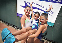 Members of the Shining Stars Synchro Team, performing their show at Miramar Regional Park